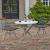 "Home Styles Du Jour Outdoor / Indoor 3-Piece Bistro Set in White Concrete, Black Powder-Coated Frame Finish, Set Includes: 35-1/2"" Round Table and (2) Chairs"
