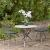 "Home Styles Du Jour Outdoor / Indoor 3-Piece Bistro Set in Gray Concrete, Black Powder-Coated Finish, Set Includes: 35-1/2"" Round Table and (2) Chairs"